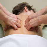 Massage de quatre mains Photo stock