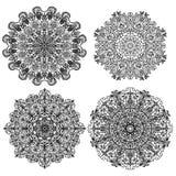 Quatre mandalas circulaires d'isolats avec l'illustration différente d'ornements Photos libres de droits