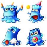 Quatre monstres bleus Photos stock