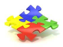 Quatre morceaux colorés de puzzle denteux réunis Images libres de droits