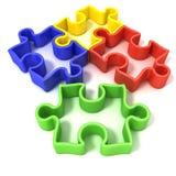 Quatre morceaux décrits colorés de puzzle denteux Image libre de droits
