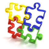 Quatre morceaux décrits colorés de puzzle denteux, réunis Photographie stock