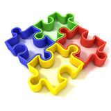 Quatre morceaux décrits colorés de puzzle denteux Vue supérieure Photo libre de droits