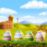 Quatre oeufs de pâques dans l'herbe Photo libre de droits