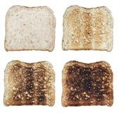 quatre pains grillés images stock