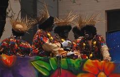 Quatre personnes dans le visage noir sur Zulu Parade Float Images libres de droits