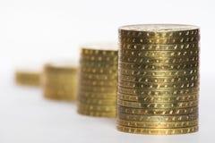 Quatre piles de pièces de monnaie Photo stock