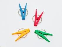 Quatre pinces à linge en plastique Photographie stock