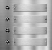 Quatre plaques de métal avec le fond de boutons Image stock