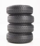 Quatre pneus d'isolement sur le fond blanc photo stock