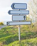 Quatre poteaux de signe vides Photos stock