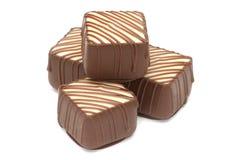 Quatre pralines de chocolat Photos stock