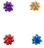 Quatre proues colorées de Noël dans les quatre coins de l'd'isolement Photographie stock libre de droits
