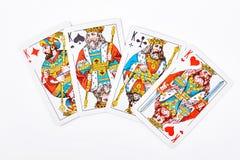 Quatre rois de jouer des cartes Photographie stock