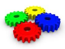 Quatre roues dentées colorées Images libres de droits