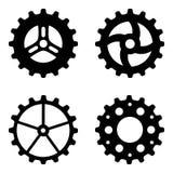 Quatre roues dentées noires Photos libres de droits