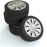 Quatre roues pour une voiture avec les disques argentés 3d rendent Images libres de droits