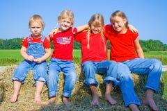 Quatre soeurs heureuses. Photos stock