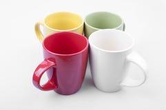 Quatre tasses colorées. Photographie stock libre de droits