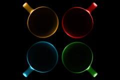 Quatre tasses de différentes couleurs Photo stock