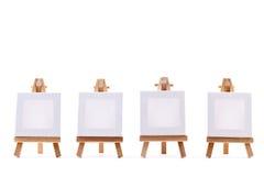 Quatre toiles en blanc sur des supports Images libres de droits
