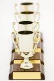 Quatre trophées Photographie stock