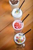 Quatre types de boisson de milkshake Images stock