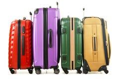 Quatre valises sur le fond blanc Photo stock