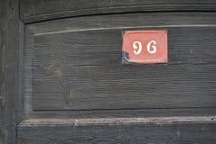 Quatre-vingt-seize numéros de maison photographie stock