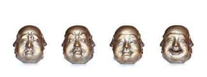 Quatre visages de la même tête de Bouddha images libres de droits