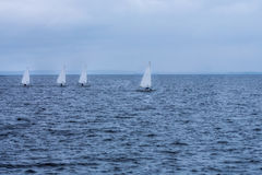 Quatre voiliers sur la mer Image libre de droits