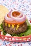 quatrième hamburger juillet juteux Image libre de droits
