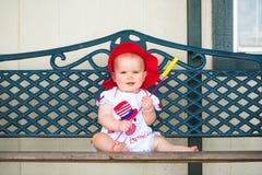 Quatrième heureux de bébé de juillet Photographie stock libre de droits