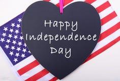 Quatrième heureux de tableau noir et de drapeau de juillet Image libre de droits