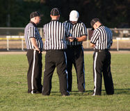 Quatro árbitros do futebol fotos de stock royalty free