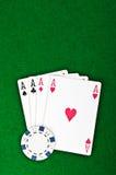 Quatro ás e microplaquetas de póquer Imagens de Stock Royalty Free