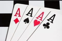 Quatro áss em um tabuleiro de xadrez Imagens de Stock Royalty Free