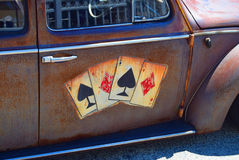 Quatro áss no carro oxidado Imagem de Stock