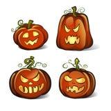Quatro abóboras de Dia das Bruxas isoladas no fundo branco Fotografia de Stock Royalty Free