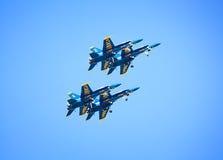 Quatro anjos azuis na formação Imagens de Stock Royalty Free