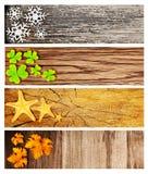 Quatro bandeiras de madeira da estação Fotos de Stock Royalty Free