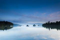 Quatro barcos no lago Imagens de Stock