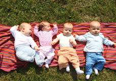 Quatro bebês Imagens de Stock