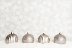 Quatro bolas de prata do Natal com 2016 Imagem de Stock