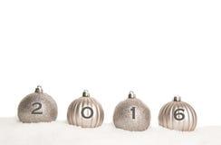 Quatro bolas de prata do Natal com 2016 Imagens de Stock