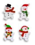 Quatro bonecos de neve sobre o branco fotografia de stock royalty free