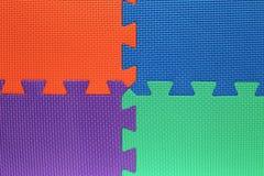 Quatro campos de cor com partes de enigma Imagens de Stock Royalty Free