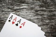 Quatro cartões de jogo do ás com copyspace Fotografia de Stock