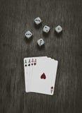 Quatro cartões e dados de jogo dos áss Foto de Stock Royalty Free