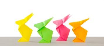 Quatro coelhos de papel no branco Foto de Stock Royalty Free
